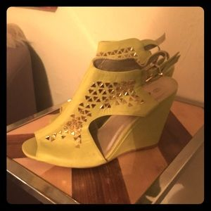 Neon green wedge sandals with gold studs.